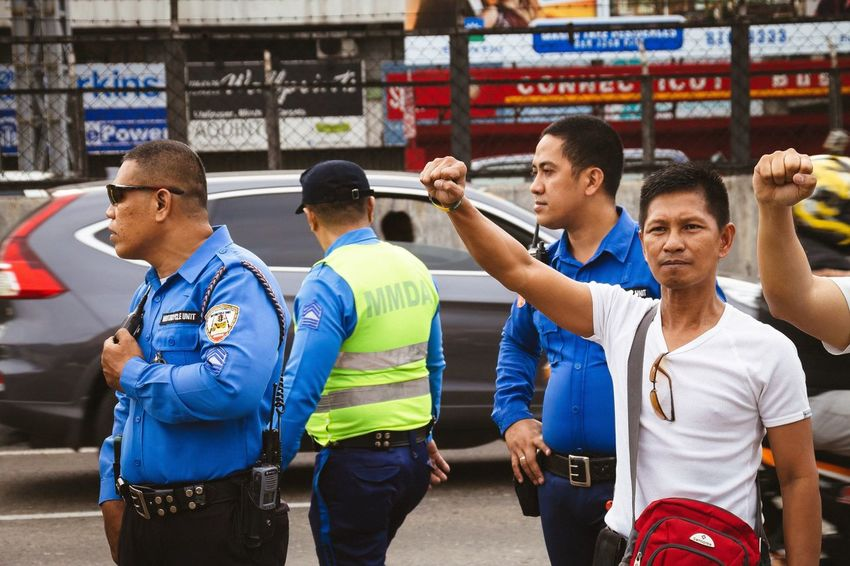 Defy Raised Fist Men Adult Police Outdoors Rally Protest Protesters Resistance  Real People People People Watching People Photography People And Places People Of EyeEm People Together Street Photography Streetphoto_color Photojournalism Edsa People Power Revolution Eyeem Philippines Resist Break The Mold