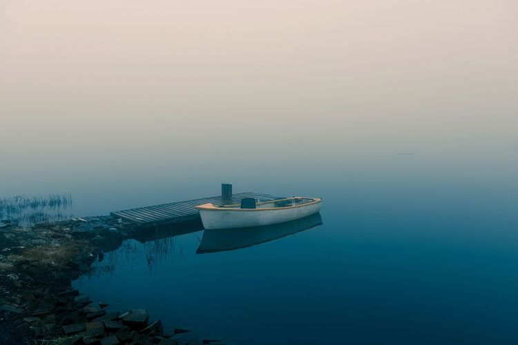 Lonely Water Fog Floating On Water Tranquility No People Outdoors Loch  Scenics Scotland Business Finance And Industry Nautical Vessel Reflection Lake Sunset Sky Nature Tranquil Scene Beauty In Nature Architecture Day