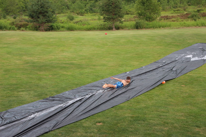 authentic red-neck slip and slide Fun Summer Fun ☀️ Day Family Fun Grass Leisure Activity One Person Outdoors Party Games People Playing Redneck Redneck Good Times Redneck Summer Games Slip N Slide Water