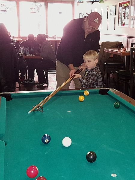 Maybe a boy's First Lesson in The Art Of Pool isnt one of those Photos That Will Restore Your Faith In Humanity but there's something about Father & Son Playing Together and Spending Time Teaching And Learning