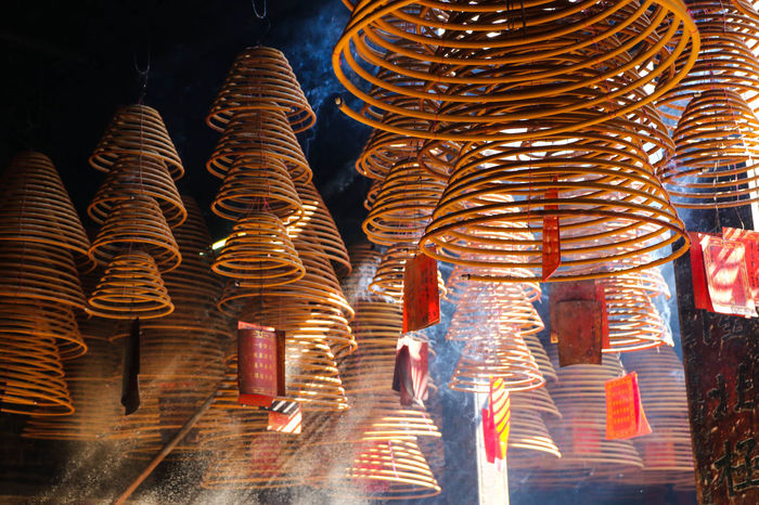 Encens Light Bouddhisme Hanging Illuminated Incense Indoors  Large Group Of Objects Light And Shadow No People Pattern Religion Spiral Spirituality Temple Wish EyeEmNewHere