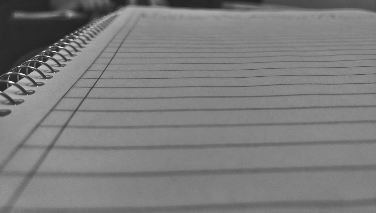 paper, spiral notebook, indoors, no people, selective focus, close-up, table, note pad, lined paper, day