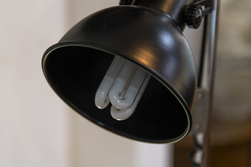 Close-up of desk lamp at home