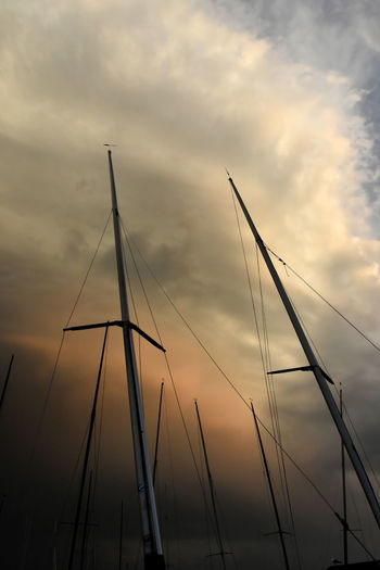 Architecture Cloud - Sky Day Looking Up At The Sky Low Angle View Mast Masts Nature Nautical Vessel No People Outdoors Sky Storm Cloud Sunset Transportation Water