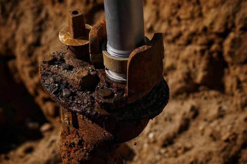 Close-Up Of Rusty Pipe Connected With New