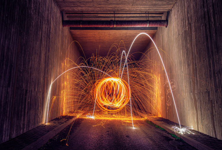 Light trails in tunnel at night