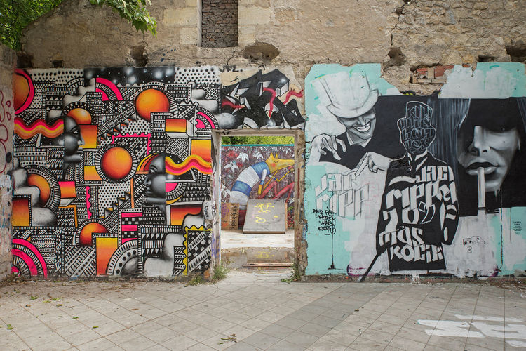 Architecture Art And Craft Building Exterior Built Structure Creativity Day Graffiti No People Outdoors Street Art Text
