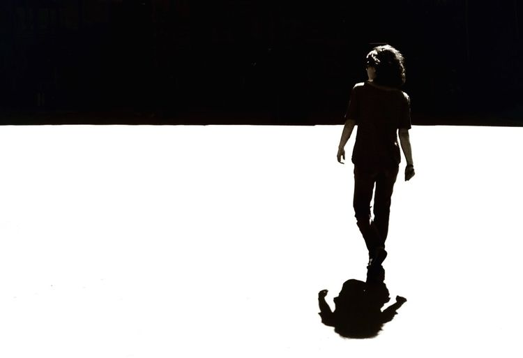 Woman standing in the dark
