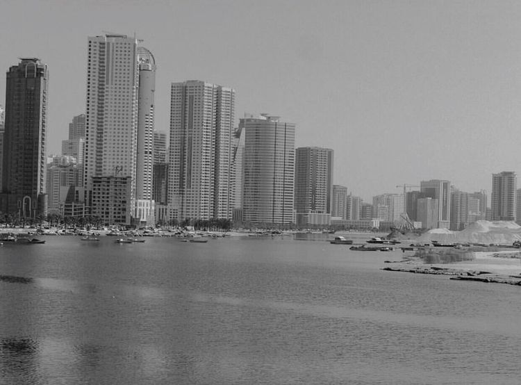 City Architecture Building Exterior Skyscraper Built Structure Urban Skyline Outdoors Water Clear Sky Cityscape Waterfront Modern UAE Blackandwhite Nautical Vessel City Life Sea Day Tall Sky Downtown District Miles Away