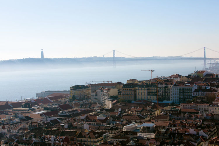 Bridge Bridge - Man Made Structure Built Structure City Cityscape Clear Sky Harbor High Angle View Jesus Lisboa Portugal Lisbon - Portugal No People Outdoors Overview River View Sea Shipping  Sky Tourism Destination Transportation Travel Destinations Urban Skyline View Water