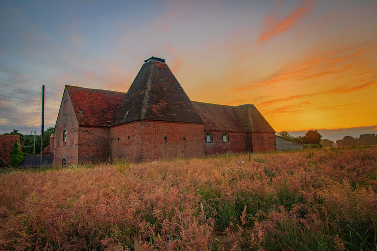 Oast House, Garden Of England, Kent, England. Architecture Sky Built Structure Nature No People Plant Hops Beer Brewing Iconic Buildings Vivid International Getty Images EyeEm Gallery Travel Destinations Tourism Sunrise Countryside Rural Scene History Sunset Building Exterior Field Land The Past Cloud - Sky Orange Color Old Building Beauty In Nature Abandoned Place Of Worship Grass Outdoors Ruined Ancient Civilization