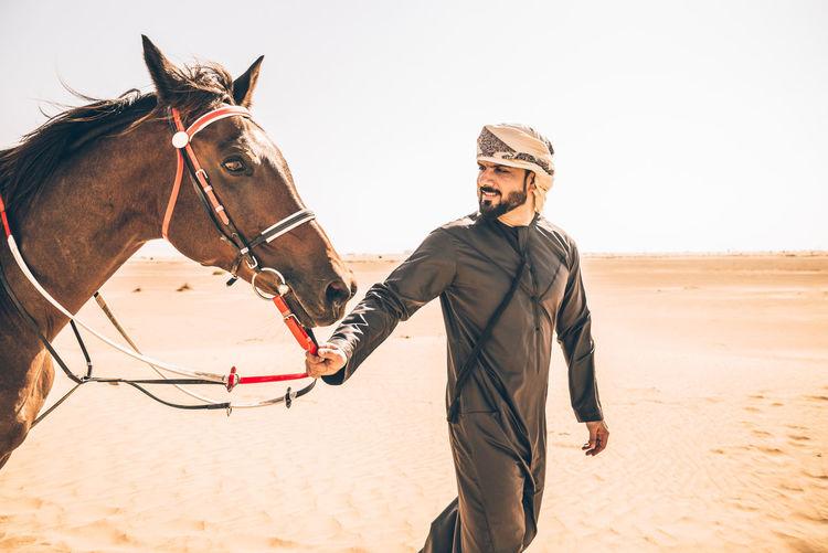 Full length of a horse on sand