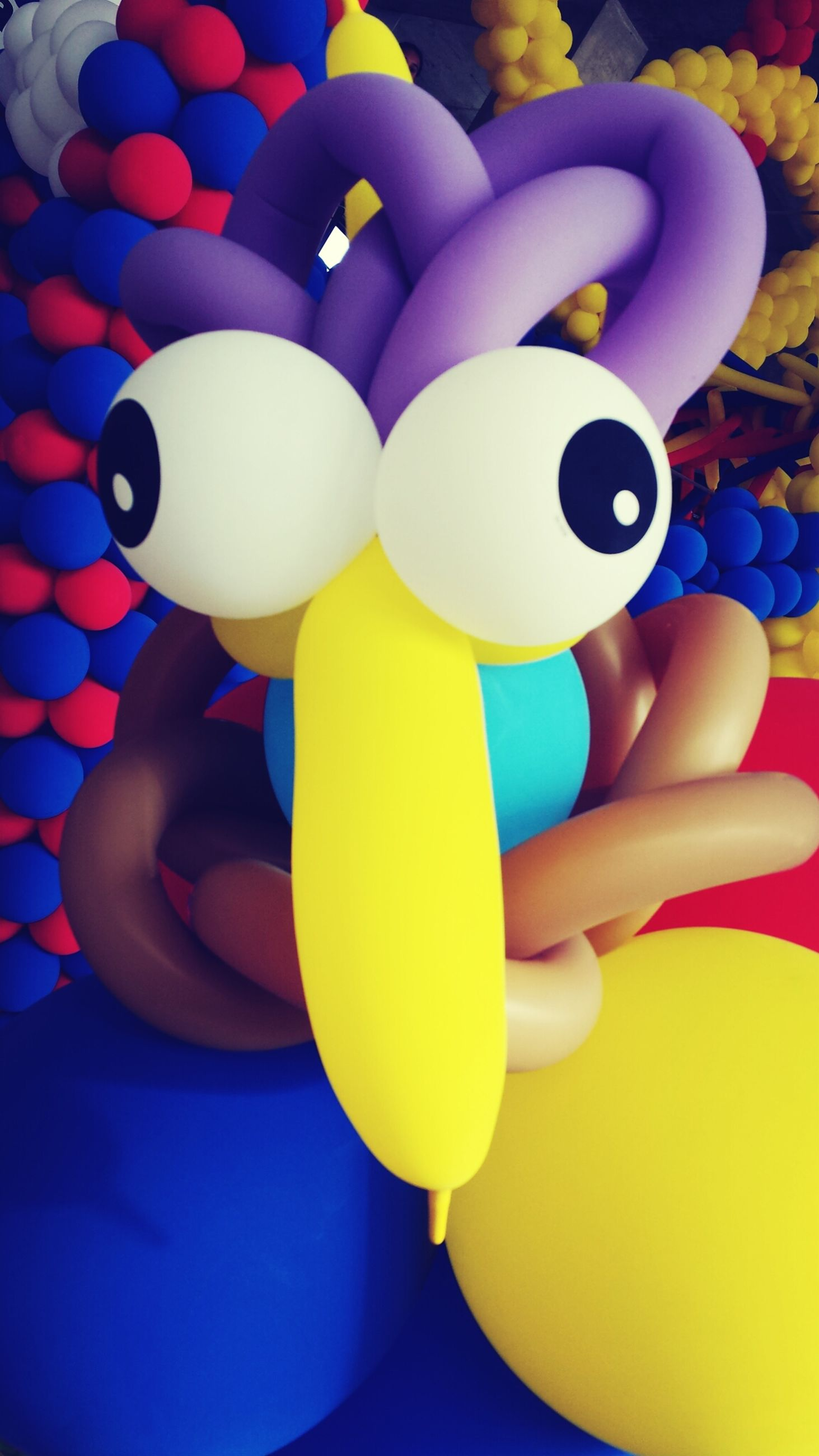 indoors, multi colored, still life, food and drink, childhood, table, drink, close-up, high angle view, blue, refreshment, yellow, colorful, one person, variation, cup, toy, plastic, large group of objects