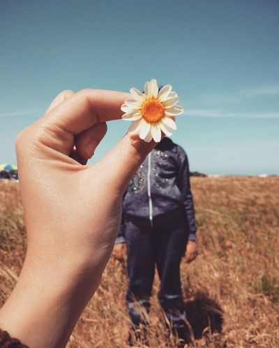 Flower One Person People Human Body Part Nature Outdoors Fragility Flower Head Holding Adult Adults Only Day Beauty In Nature Plant Only Women Human Hand Close-up One Woman Only Rural Scene Sky The Week On EyeEm EyeEmNewHere Perspectives On Nature Rethink Things