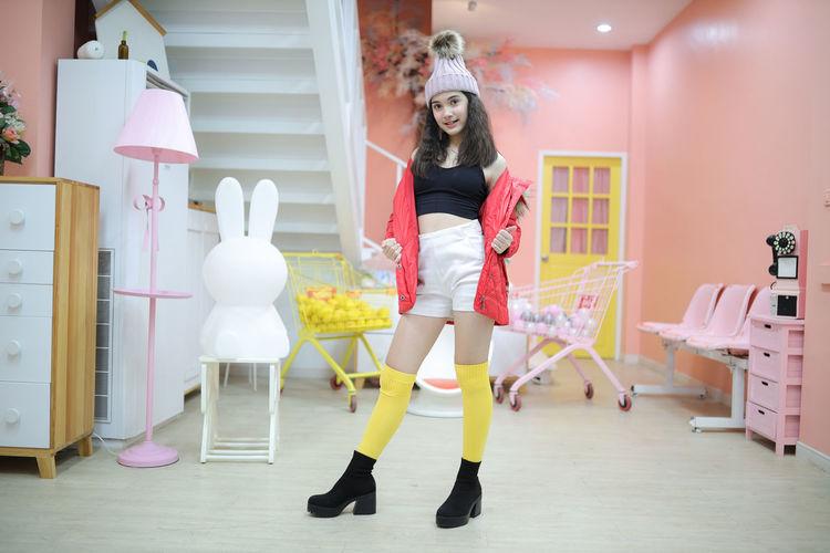 Portrait of happy girl standing in corridor