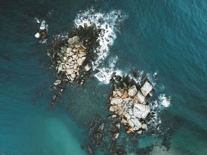 High angle view of rock in sea
