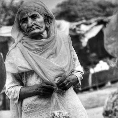 Of folded skin And untold battles fought within. I spotted her in a Sunday Bazar near Chiniot arguing with the fruit vendor while failing to strike a bargain. The sun was unbearably harsh that summer noon, and it blazed her face as if accentuating the marks of labor on her face. After several attempts at insisting to bring down the price, I saw her leaving the market with nothing more than a half eaten pack of raw peanuts in her hand. She seemed oblivious of my presence at that point, as I was sitting in a car at a distance. As I neared her and caught her attention, I lifted up my camera and hinted for her permission. I took her nod as a sign of approval and kept clicking while she looked around herself - as if wondering what she'd take home that day. Streetphotography Streetlife. Streetwise Theroadsidelife