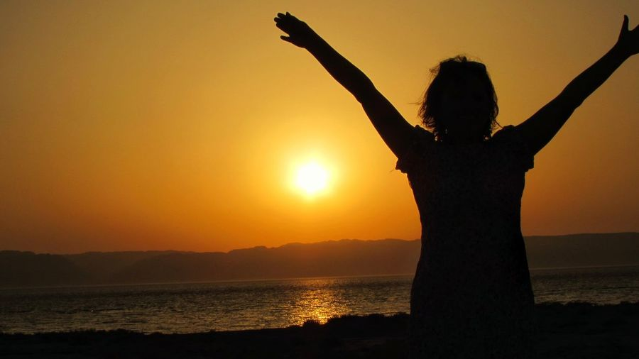 Looking at the destinations Silhouette Sunset Human Arm Arms Raised Human Body Part One Person People Adult One Woman Only Only Women Adults Only Outdoors Night Nature Sky Sea Water Women Horizon Over Water Young Adult Miles Away Travel Destinations Beauty In Nature Vacations Arabia