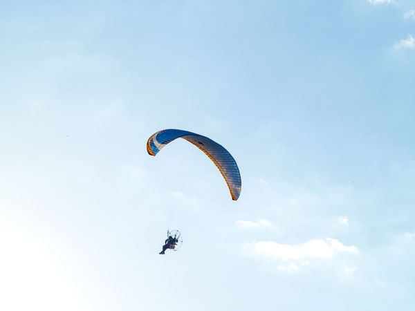 Adventure Adventure Sports Aereal View Day Extreme Extreme Sport Extreme Sports Flying Flying High Leisure Activity Lifestyles Man Mid-air Nature One Person Outdoors Parachute Paraglider Paragliding People Real People Sky Sky And Clouds Sport