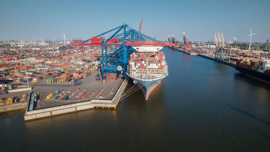 High angle view of commercial dock against clear sky