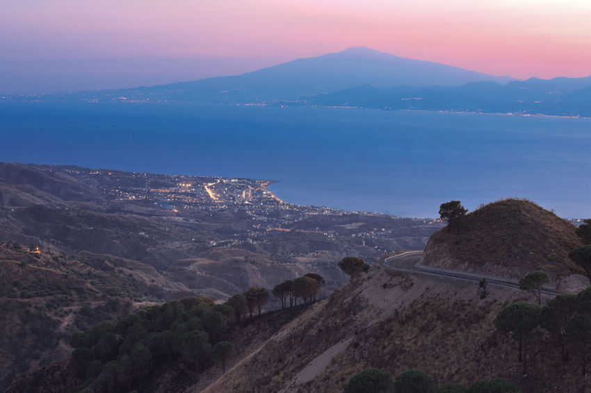 View from Aspromonte on Etna volcano through Messina strait Aspromonte Calabria Countryside Dusk Etna HDR High Angle View Idyllic Landscape Mediterranean  Messina Strait Mountain Mountain Road No People Non-urban Scene Outdoors Remote Scenics Sea Sicily Tranquil Scene Tranquility Travel Destinations Volcano Water