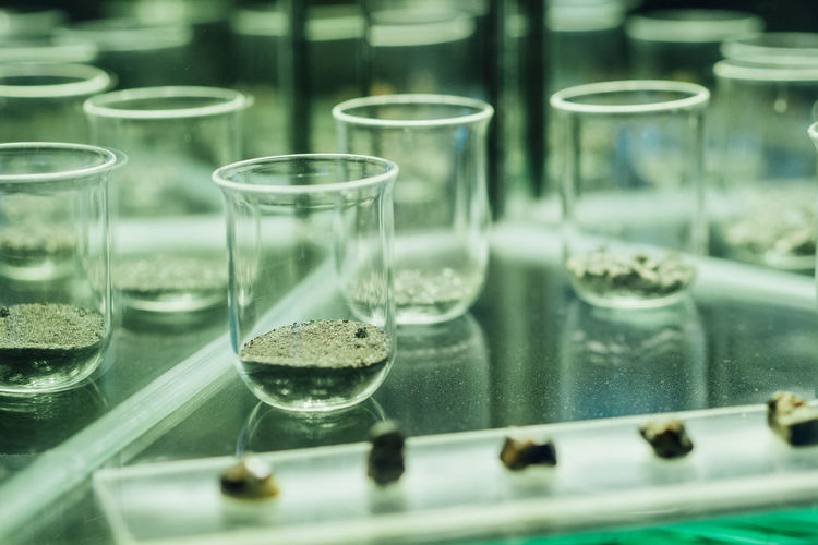 Minerals in laboratory glassware on table