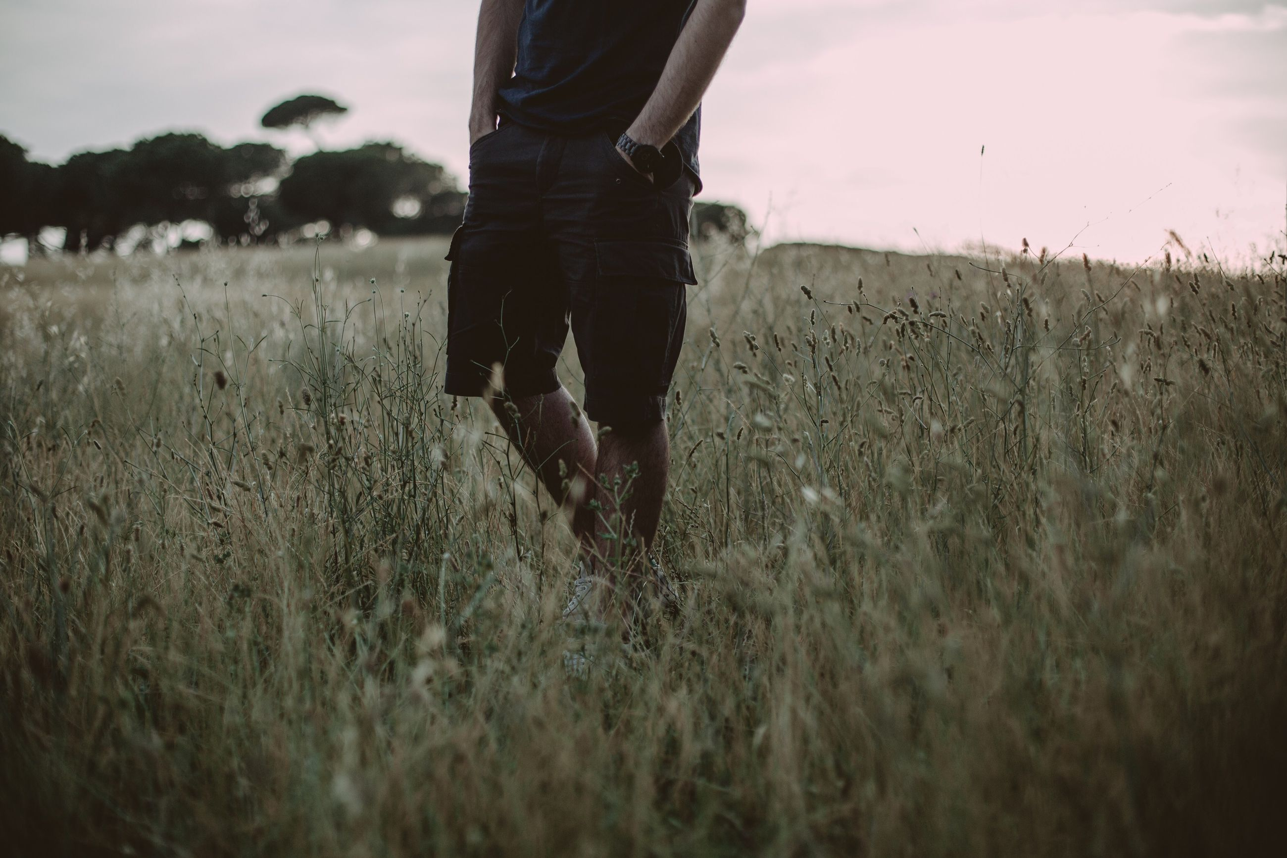 field, one person, grass, nature, real people, low section, growth, walking, outdoors, standing, men, day, plant, sky, people