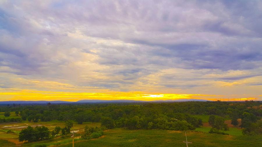 วิวที่วัดเขาตะเงาะอุดมพร Dramatic Sky Sunset Cloud - Sky Field Rural Scene Nature Agriculture Scenics Landscape Yellow Beauty In Nature Sun Tranquil Scene Summer Sunlight Tranquility Gold Colored Multi Colored Plant Sky The Great Outdoors - 2017 EyeEm Awards