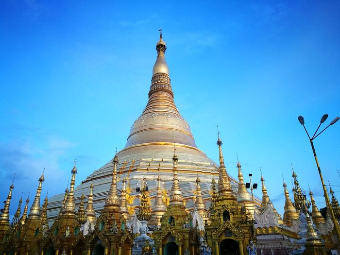 Religion Architecture Pagoda Spirituality Gold Sky Arrival Business Finance And Industry Travel Destinations Ancient Gold Colored Statue Adulation Outdoors No People Building Exterior Day Ancient Civilization Nature