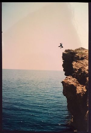 Dropping a cliff in Greece 🇬🇷! Throwback Cliff CliffJumping Greece Flying Gobigorgohome Sea Horizon Over Water Water Nature Scenics Tranquil Scene Tranquility Outdoors Sky Beauty In Nature Clear Sky Beach Day Sunset Men One Person People