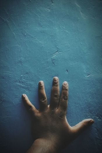 Cropped Image Of Hand On Wall