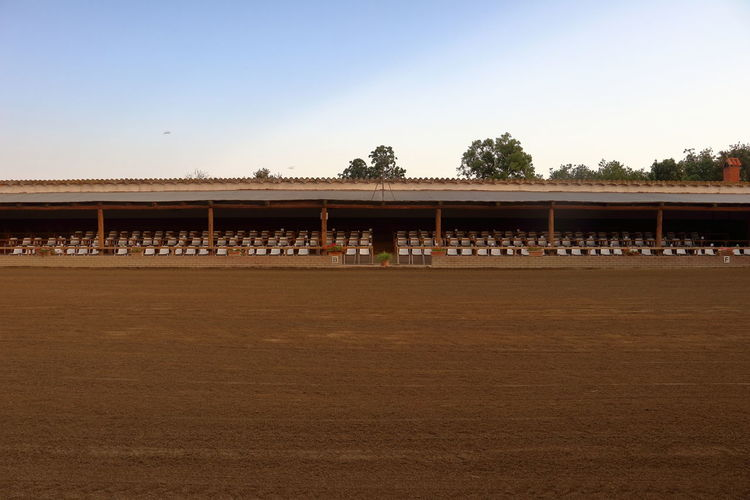 Spanish riding hall ready for competitions Dressage Rider Roof Competition No People Paddock Purebred Race Ride Riding Hall Riding Lesson Riding Place Sand Sandy School Spaın Sport Stall Training