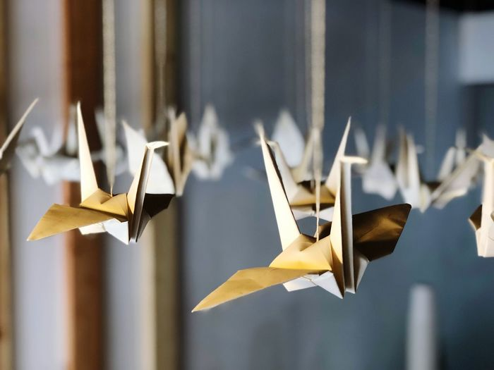 Close-up of hanging origami birds