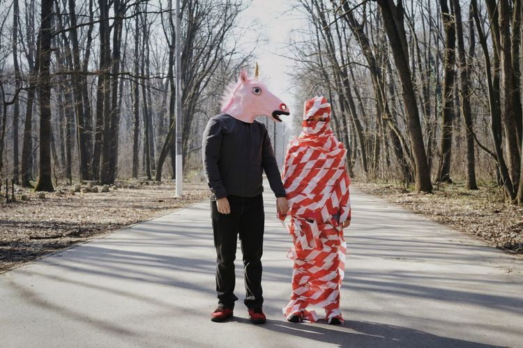 Love Forest Road Unicorn Unicorn Head Mask Mask - Disguise Two People Forest Road Bare Trees People Centered Hiding Face Face Hidden Couple - Relationship Couple Warm Clothing Tree Full Length Cold Temperature Winter Young Women Togetherness Bare Tree Happiness Friend Disguise Superhero Costume Inner Power Visual Creativity