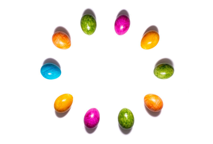Directly above shot of multi colored candies on white background