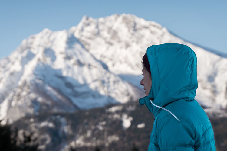 Side view of person on snowcapped mountain