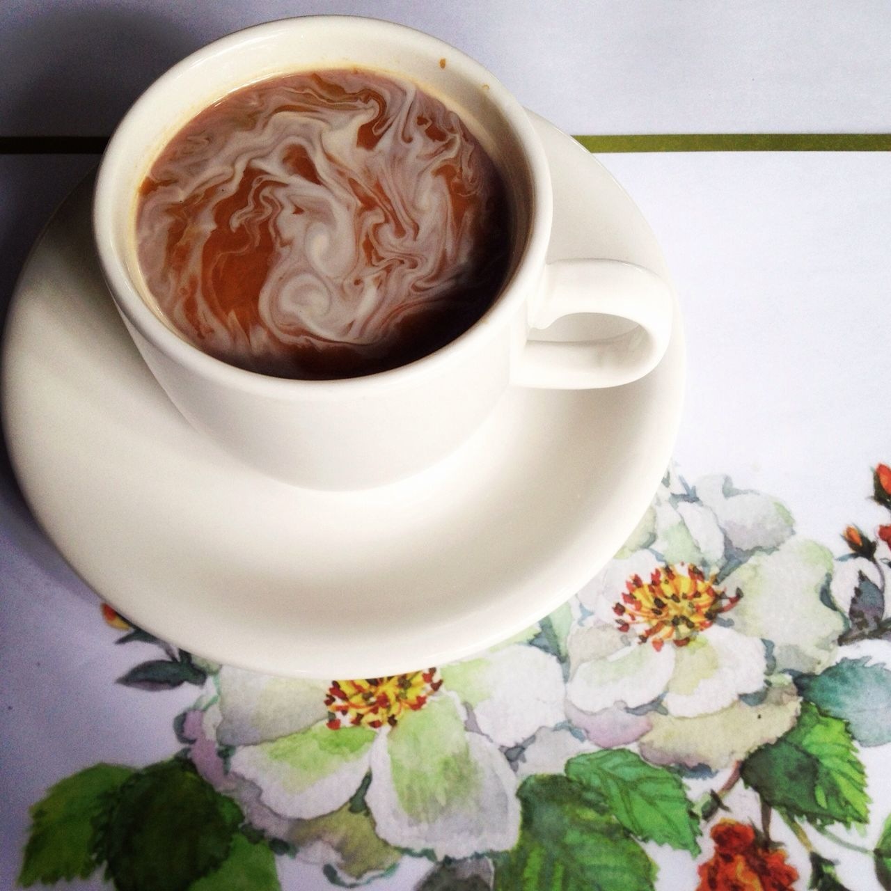 Close-up of coffee served on table in cafe