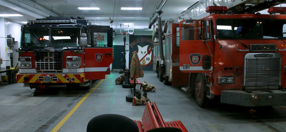 Photos taken in and around Montreal, fall of 2018. Montréal City Urban Streetphotography Transportation Mode Of Transportation Land Vehicle Red Truck Public Transportation Fire Truck Fire Station Indoors  Illuminated Fire Engine Motor Vehicle Working Real People
