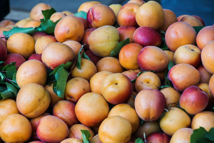 Close-Up Of Peaches For Sale At Market