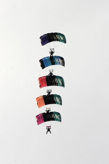 Stack Canopy Formation Clear Sky Connection Extreme Sports Full Length In A Row Low Angle View Multi Colored Parachuting Real People Sky Skydiving Stacked Togetherness Trust White Background