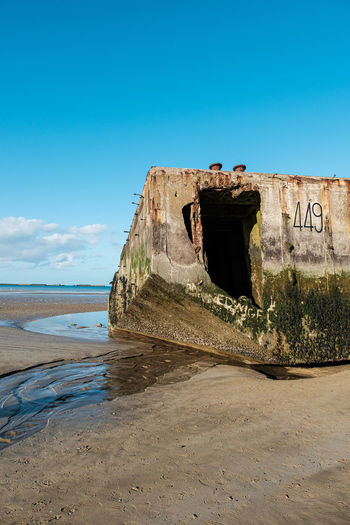 Remains of a world war 2 vessel used for an artificial harbour after landing on d-day.