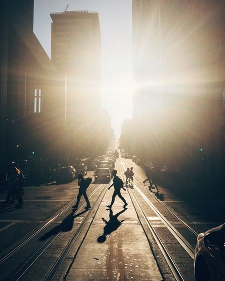 Architecture Building Exterior Built Structure City City Life Day Group Of People Large Group Of People Lens Flare Men Outdoors People Railroad Track Real People Silhouette Sky Sun Sunbeam Sunlight Transportation