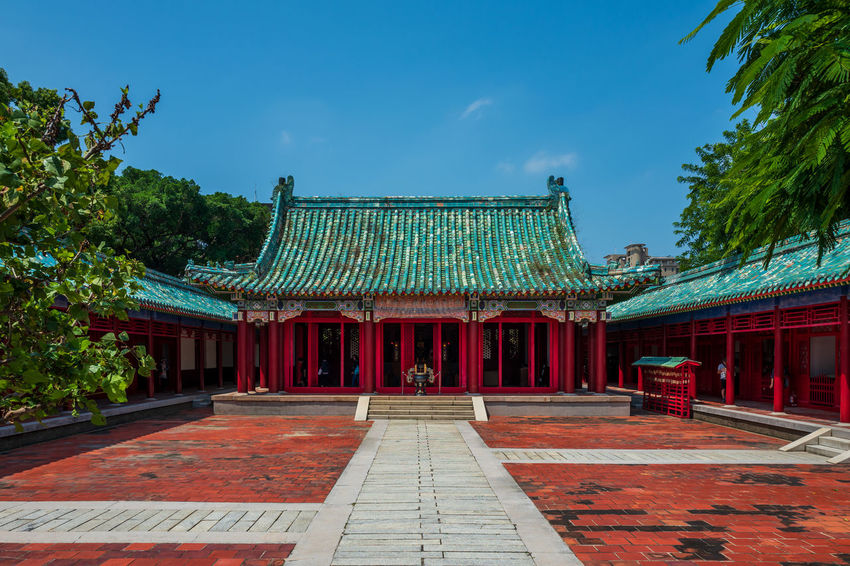 Tainan, Taiwan Architecture Belief Blue Building Building Exterior Built Structure Courtyard  Day Entrance Nature No People Outdoors Place Of Worship Plant Red Religion Sky Spirituality Travel Destinations Tree