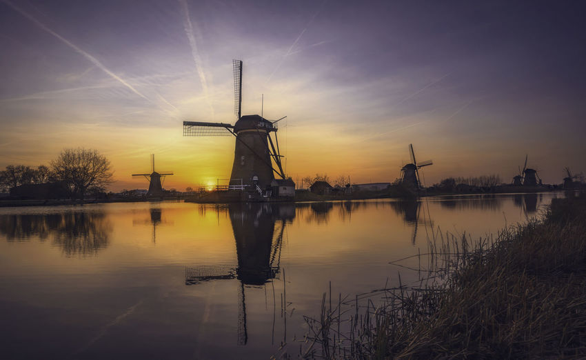 Remo SCarfo Windmills Sunset Holland Dutch Reflection Sky Water Wind Power Turbine Wind Turbine Fuel And Power Generation Renewable Energy Alternative Energy Environmental Conservation No People Traditional Windmill Nature Architecture Beauty In Nature Lake Silhouette Scenics - Nature Sun