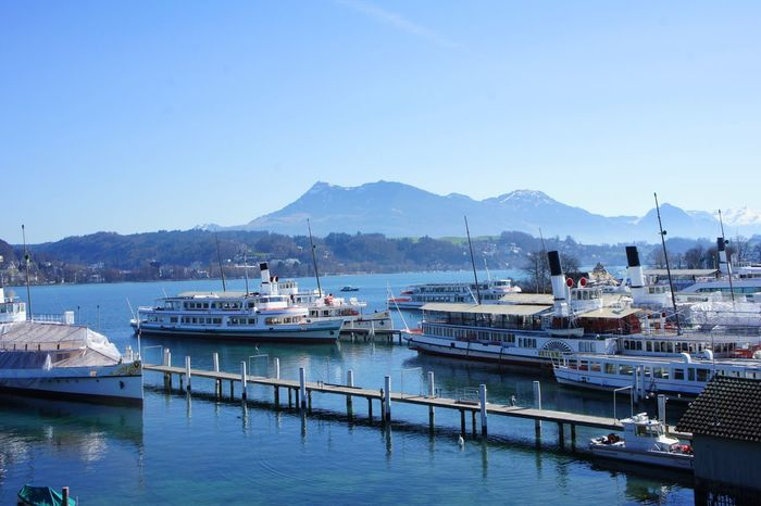 Steamboats on Lake Lucerne Architecture Beauty In Nature Blue Day Harbor Lake Lucerne Mode Of Transport Moored Mountain Mountain Range Nature Nautical Vessel No People Outdoors Passenger Craft Pier Rigi Sea Sky Steamboat Transportation Vierwaldstättersee Water Yacht Yachting Flying High The Great Outdoors - 2017 EyeEm Awards
