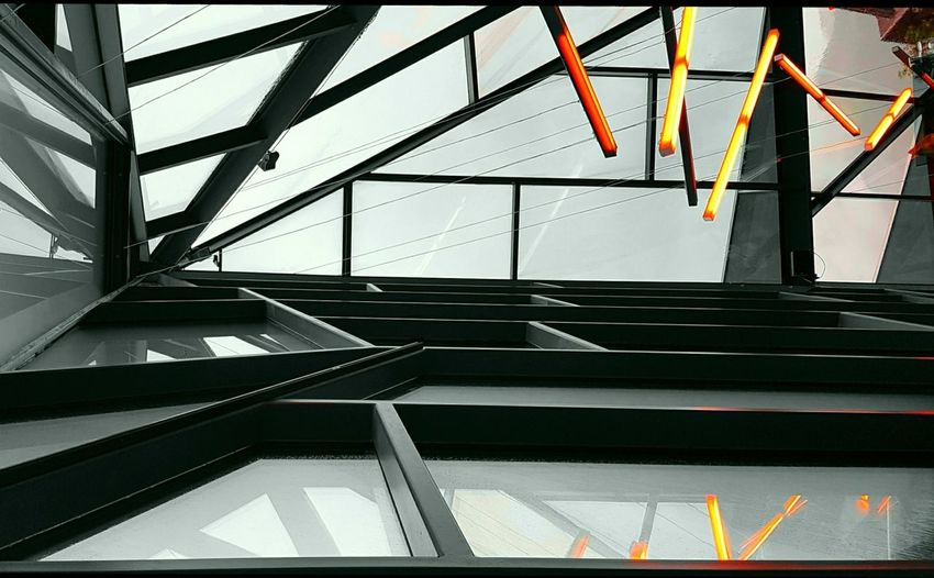 """With cropping, a new integrity appears and winning abstractions flutter up like butterflies. You can afford to be critical, discriminating, innocent, open-minded, charmed, beguiled or bamboozled."" Robert Genn. Glass Roof Edited My Way Colour Selective Architecture Built Structure No People Low Angle View Stein Oil Museum Roof Girders Indoors  Electric Lights Sky Above Abstract The Week On EyeEm Artistic Edited Reflection Vacations The Graphic City"