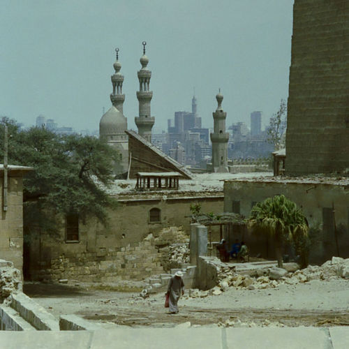 Streets of Cairo 1992 1992 Analogue Photography Architecture Building Exterior Built Structure Façade Footpath History Local Landmark Minarets Outdoors Place Of Worship Scan The Past Unrecognizable Person Walking