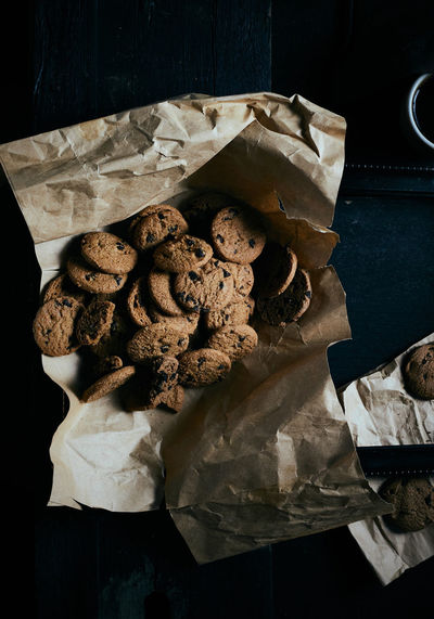 Chocolate chip cookies on rustic background. Coffee Drink Food And Drink Food High Angle View Cookie Chocolate Chip Snack Biscuit Homemade Still Life Foodphotography Lifestyles Dessert Sweet Top View Darktone Moodshot Prop