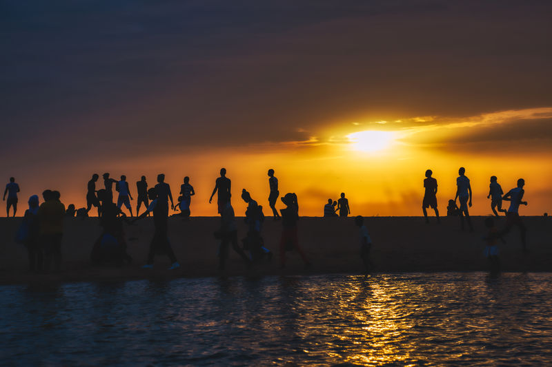 Crowdy Sunset at somone lagoon Sunset Group Of People Water Sky Sea Real People Men Large Group Of People Waterfront Crowd Orange Color Beauty In Nature Silhouette Leisure Activity Scenics - Nature Beach Nature Lifestyles Togetherness Sun Horizon Over Water Outdoors Silhouette