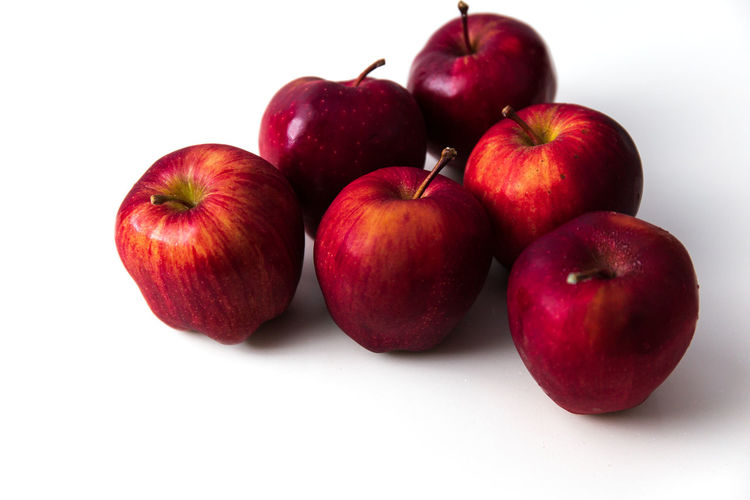 High angle view of apples on apple against white background